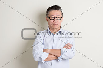 Portrait of mature Asian male people arms crossed