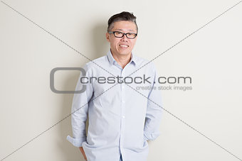 Portrait of mature Asian man