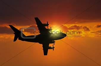 Airplane flying during sunset