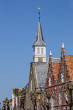 Church tower and facades in the historical center of Sloten