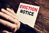 young man who has received an eviction notice