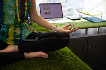 Business Woman Doing Yoga Meditation On Office Desk