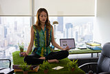 Business Woman Doing Yoga Meditation On Table In Office