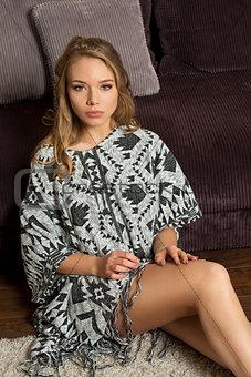 beauty blond woman , sitting on floor