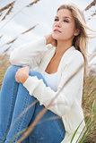 Beautiful Woman Girl Sitting in Long Grass on beach