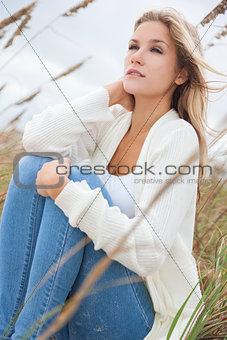 Beautiful Woman Girl Sitting in Long Grass on beach