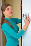 woman push button digital thermostat
