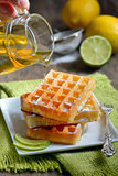 stack of waffles with honey