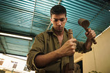 Young Sculptor Artist Working And Sculpting Wood Statue-4