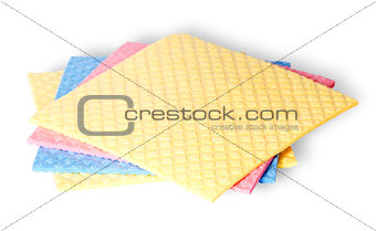 Are scattered colorful sponges for dishwashing
