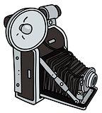 Vintage camera with a flashlight