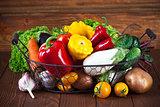 Fresh vegetables in basket on wooden board
