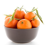 Tangerines on ceramic brown  bowl