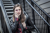 Young Bruised and Frightened Girl With Backpack on Staircase