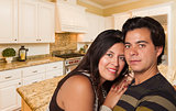 Hispanic Couple Inside Custom Kitchen Interior