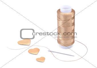 Thread, needle and hearts