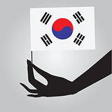 Hand with flag South Korea