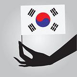 Hand with flag South Korea