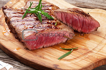 Grilled beef steak with rosemary, salt and pepper