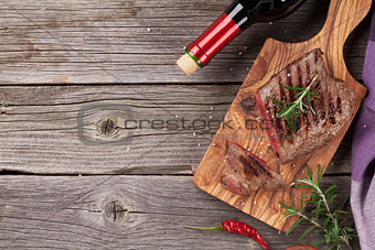 Grilled beef steak with rosemary, salt and pepper and wine