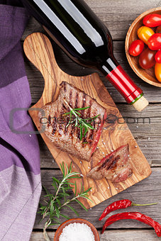 Grilled steak with spices and wine