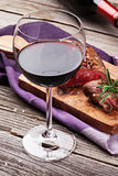 Red wine glass and grilled beef steak