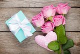 Gift box, pink roses bouquet and heart toy