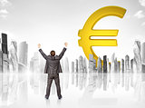 Businessman in front of big euro