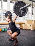 Young man lifting at a crossfit gym