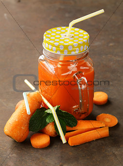 Fresh carrot juice (smoothies) in a glass jar, healthy food