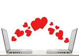 two laptops with hearts