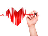 Closeup of hand drawing heart beat in heart shape with stethoscope