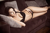 sexy lady lying on sofa