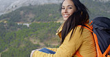 Happy vivacious young woman backpacker