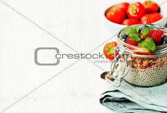 Ð¡hia seeds vanilla pudding and berries on wooden rustic backgr