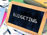 Budgeting Concept Hand Drawn on Chalkboard.