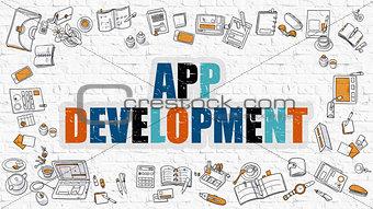App Development on White Brick Wall.