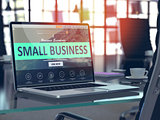 Small Business on Laptop in Modern Workplace Background.