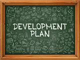 Development Plan - Hand Drawn on Green Chalkboard.