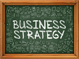 Green Chalkboard with Hand Drawn Business Strategy.