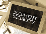 Document Security Handwritten by White Chalk on a Blackboard.