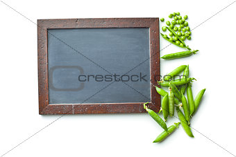 blank chalkboard and green peas