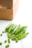 fresh green peas on kitchen table