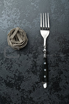 black tagliatelle pasta and fork