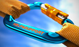 Help and Support on Blue Carabiner between Orange Ropes.