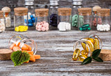 Alternative medicines with green leaves in glass containers