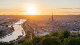 Panorama of the city of Rouen at sunset with the cathedral and the Seine.