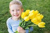kid holding flowers