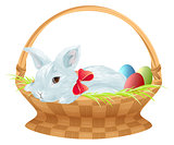 Easter bunny in wicker basket. Cute easter bunny sitting in basket with color eggs