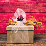 gift ornamented with flowers, natural fibers and tulle
